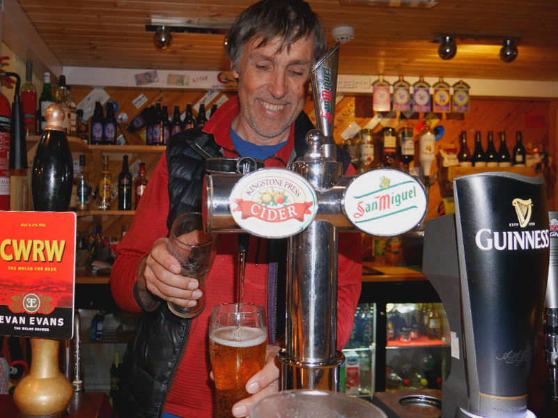 Barman serving a pints of Cider in The Paddlers Return