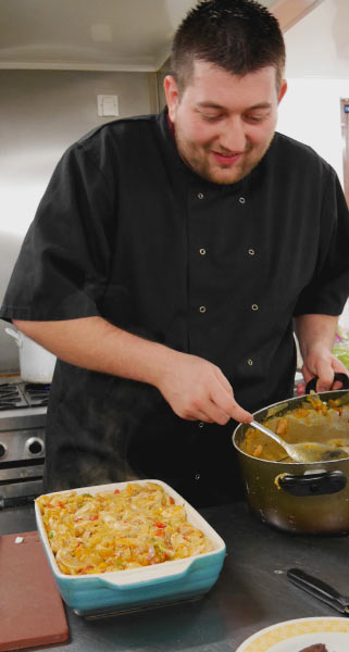 Head Chef preparing a pasta bake
